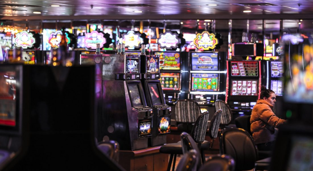 a-woman-wearing-a-brown-down-coat-playing-slot-machines-at-the-binion-s-hotel-it-reopened-this-year_t20_GJOA03